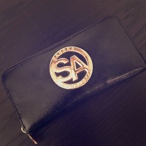 Black leather wallet with gold hardware